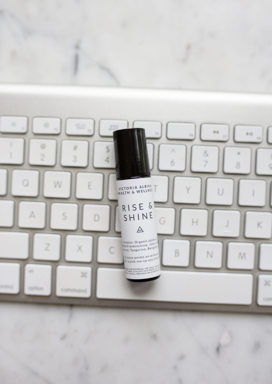 Rise and shine essential oil roller on keyboard