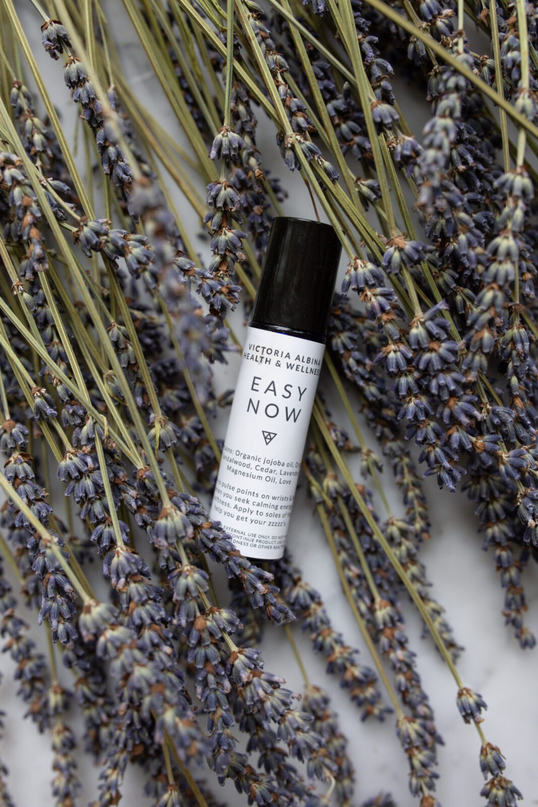 easy now essential oil roller on lavendar